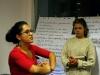 Marta and Anna explain a point. Photo by Máté Balogh.